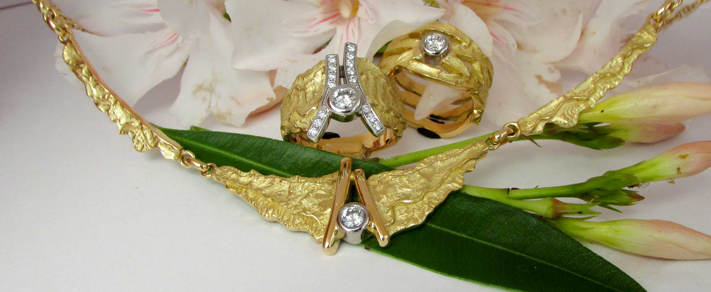 Rings and necklace with diamonds all hand made by adamas