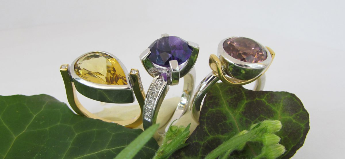 Rings in yellow and whitegold with precious stones