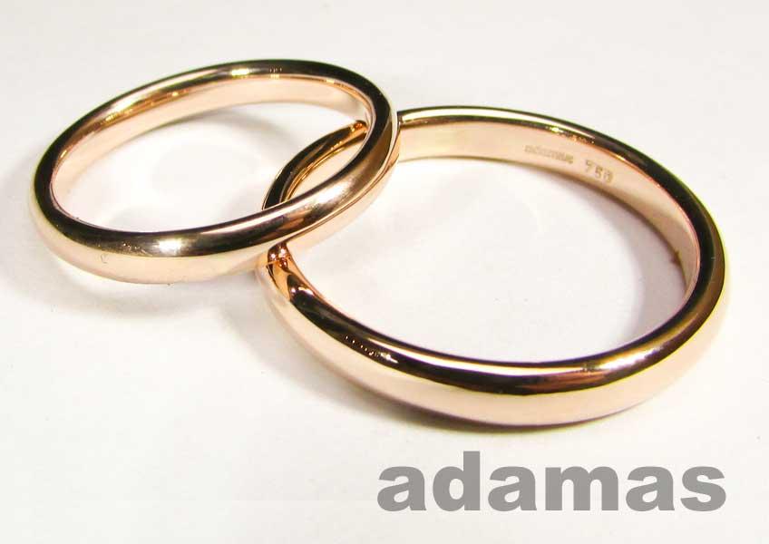 Un paio di Fedi matrimoniali oro rosso di 18-Karat